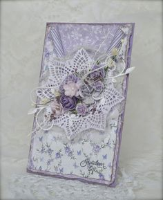 card made with papers, stamps and flowers from Papirdesign.