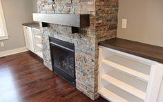 Cabinets and stone fireplace. johnfarhathomes.com