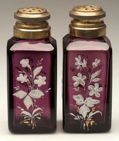 SQUARE - ROYAL PAIR OF SALT AND PEPPER SHAKERS, amethyst, white enamel and gilt floral decoration and matching, period, two-part lids. Fourth quarter 19th century.