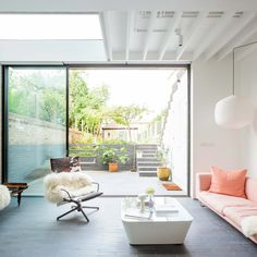 The reconfiguration, lowering, and extension of a four-story townhouse in Lewisham, to make a high-ceilinged living space overlooking a new terraced garden. Retained elements of the existing building - pipework, joists and boards, crude splice plates, heavy beams, and original strutting - were unified in white paint.  📐OEB Architects 📷Whitaker Studio 🔧Cantifix  #skyframe #aviewnotawindow #open #architecture #indooroutdoor #living #london #townhouse #light #view #modern #design #home Terraced Garden, Open Architecture, London Townhouse, Steel Stairs, Indoor Outdoor, Outdoor Decor, Home Photo, White Paints, Beams