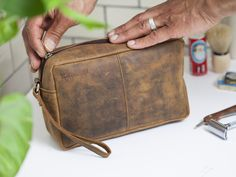 View our Men's Leather Wash Bag from our range of men's toiletries! What a great gift for him this Christmas, right? Our men's wash bags are affordable and pratical and that's why they make perfect gifts for him. Best Travel Accessories, Leather Accessories, Unique Gifts For Men, Gifts For Him, Distressed Leather, Leather Men, Vintage Leather, Unique Valentines Day Gifts, Best Valentine's Day Gifts