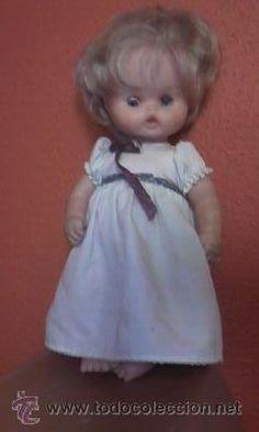 Preciosa muñeca mi primer diente de famosa. Años 80 Ojos azules iris margarita.