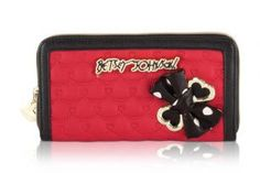 Betsey Johnson Boxed Side Bow Zip Around Wallet - Red - For the perfect blend of fashion and function, get the stylishBetsey JohnsonBow Wallet. It'sconstructed ofQuilted PVC detail,frontSignaturebow and zip closure, wallet features thepracticalstorage space of 8 cc slots ,2 bill pockets,and coin compartment.Packaged in a signature gift box it will make the perfect gift for someone special!