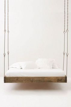 Hanging bed for the sunporch. love this one with an industrial edge vs. nautical rope.