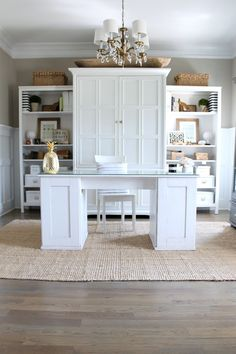 Home Office Storage - this is actually two IKEA bookcases and an unused entertainment unit, placed together and painted the same color, look like a custom made built-in + Summer Home Tour - via Chic California Home Office Storage, Home Office Space, Home Office Design, Home Office Decor, Home Decor, Office Ideas, Office Designs, Loft Office, Interior Office