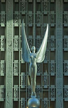 Art Deco ~ New York City | Angel above the entrance of the Waldorf-Astoria Hotel, Park Avenue. Designed by Schultze & Weaver, 1931. Photo © Jake Rajs, 2010.