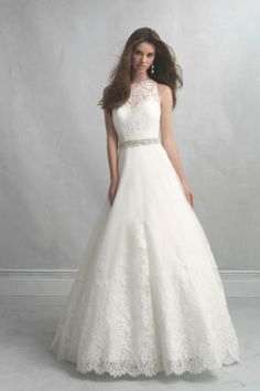 Gorgeous Allure Bridals wedding dress: http://www.stylemepretty.com/2014/10/29/12-high-neckline-dresses-that-are-absolutely-stunning/