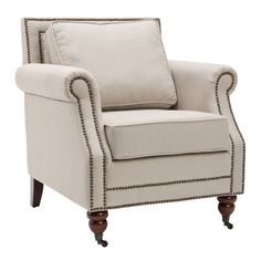 Beautifully blending modern style and classic appeal, this wood-framed arm chair showcases linen upholstery and nailhead trim.    Produ...