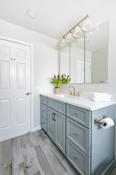 Kitchen Design, Renovations & Remodeling NJ Our kitchen remodeling projects are designed within your budget, including labor, materials. Bathroom Small, Upstairs Bathrooms, Grey Bathrooms, Quartzite Countertops, White Countertops, Blue Cabinets, Shaker Cabinets, Grey Flooring, Plank Flooring