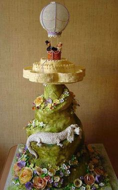 """I know I've pinned it before, but I can't get enough of this cake with Falcor from """"The Neverending Story""""! Sorry I don't know the name of the cakery that made it!"""