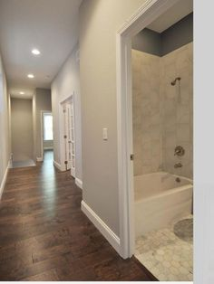 Wall colors are neutral.  Love the floors.  This is your new look of the hall way.  The grey makes your space look bigger.