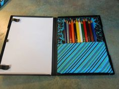 How to make an art kit from a dvd case. I'm thinking a travel Pictionary game too.