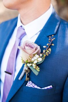 The groom's boutonniere is one of the few accessories for the groom. The small boutonniere declares the identity of the groom. The groom's boutonniere should be based on simplicity and smallness. Remember, the boutonniere and Read more… White Tuxedo Wedding, Blue Suit Wedding, Wedding Suits, Bright Blue Suit, Blue Tux, Blue Suits, Sparkle Wedding, Mod Wedding, Chic Wedding