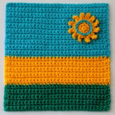Flag of Rwanda - Anneke S. To learn more about our organization go to www.knit-a-square.com  To meet our members and see more of our knitting and crochet go to http://forum.knit-a-square.com/