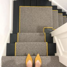 Black and White Pin Stripe Stair Runner with Yellow Serged Border on Black Painted Stairs