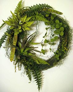 Foliage wreath - a contemporary twist - grapevine wreath, faux ferns, faux bromeliads, faux tropical foliage, faux Spanish moss, natural stepp fruit pods, natural reindeer moss, 32 inches wide