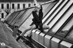Black and white photo of Natasha smoking on a loft roof in Milan
