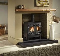 Wood burning fireplace design with a sophisticated European-style combines powerful catalytic heating - Hupehome Wood Stove Surround, Wood Stove Hearth, Wood Burner Fireplace, Slate Hearth, Inglenook Fireplace, Home Fireplace, Fireplace Design, Fireplace Ideas, Houses