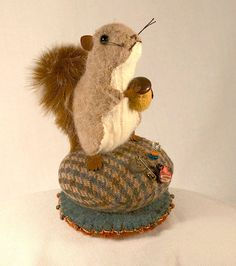 Squirrel on a Tuffet Pincushion - Teal and Ginger Houndstooth Wool. $34.50, via Etsy.