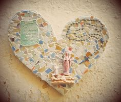religous mosaic heart made from found and unwanted objects