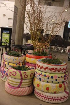"Another way to recycle tires at the chicago flower and garden show    For More Fantastical Home and Garden Whimsy Ideas, visit Dig-in.co    ""Jonesboro, AR and West Tennessee's Premiere Whimsical Nursery, Lawn-care, Landscape and Lighting Dreamers"""