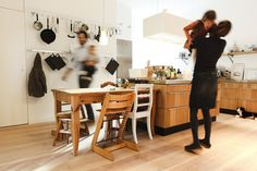 Clara Fürstenhaupt, an avid cook, chose long industrial-style metal rails along one kitchen wall to display cooking equipment in the home.