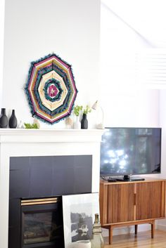 You might have made a simplified version of this wall hanging at summer camp with popsicle sticks and string. Make the adult upgrade by using different styles of yarn for a more textured feel. Get the tutorial at Simply Grove.
