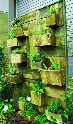 really cool vertical planter made out of reclaimed wood