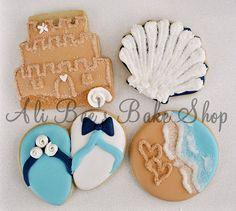 Beach Themed Wedding Cookies....I like the coastal line cookie.