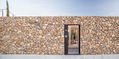 Image 7 of 23 from gallery of AA House / Alventosa Morell Arquitectes. Photograph by Adrià Goula Garage Guest House, Smart Home Design, Garage Interior, Wooden Shutters, Architecture Awards, Brick And Stone, Stone Walls, Garage Design, Stone Houses