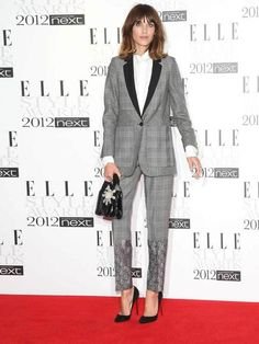 Alexa Chung arrives on the red carpet to host the ELLE Style Awards 2012 wearing a Stella McCartney suit, 13th February.