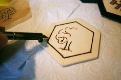 """Pin for Later: Whoa! 1 Woman Made Her Own Incredible Settlers of Catan Board  """"Burning the patterns."""""""