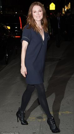 In the Navy: Julianne Moore took the plunge in a deep V-neck dress as she headed to the Late Show with Stephen Colbert in New York on Tuesday