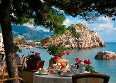 Dining over the Bay of Mazzarò at Villa Sant' Andrea, Sicily, Italy. https://www.facebook.com/exquisitecoasts