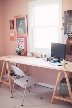 love this simple, wooden desk with tons of surface area