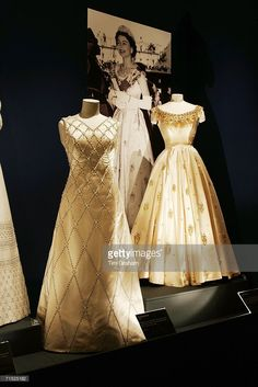 Dresses designed by Sir Norman Hartnell for Queen Elizabeth II, at an exhibition of her dresses and jewels worn over sixty years in the State Rooms of Buckingham Palace during the summer opening on July 2006 in London, England. Norman Hartnell, Vintage Gowns, Vintage Outfits, Vintage Fashion, Pretty Dresses, Beautiful Dresses, Lace Dresses, English Royal Family, Isabel Ii