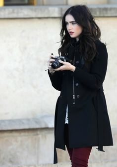 Actress: Lily Collins - love the pale makeup, dark lips and blush framed in by her black hair and coat