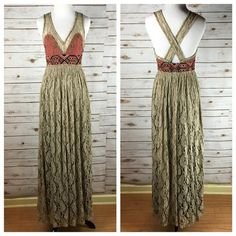 """[Free People] Crushed Gold Lace Boho Dress Prom Lightweight threads craft a floor-sweeping maxi dress embellished with gold lace embroidery at the sleeveless v-neck bodice and a woven geo-print band at the empire waistline. Lined. Hidden side zip. Slit at front center of skirt. Pictures don't do this dress justice, it is breathtaking.   Color: FP calls it *Blackened* Fabric: 80% Rayon 20% Nylon Size: 2 Bust: 14"""" Waist: 13"""" Length: 58"""" from shoulder to hem Condition: NWT! No flaws!   No…"""