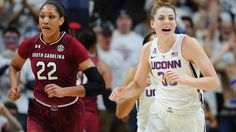 Connecticut's Katie Lou Samuelson reacts after a UConn basket as she runs up court with South Carolina's A'ja Wilson, left, in the first half of an NCAA college basketball game, Monday, Feb. 13, 2017, in Storrs, Conn.