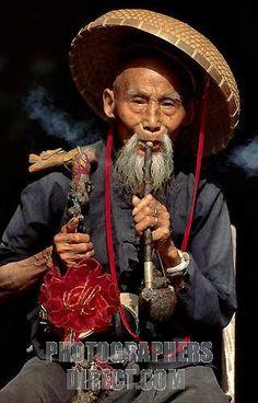 Old Man Smoking Pipe | old man smoking with smoking pipe , Yangshuo , China stock photo