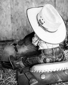 He's got the right get up on, and he'll grow into that saddle. #LittleCowboy #CowboyHat #Cute