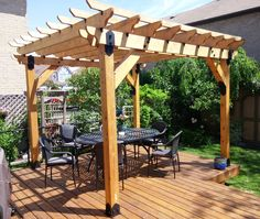 Outdoor Living Pergola Built Using Post Bases Rafter