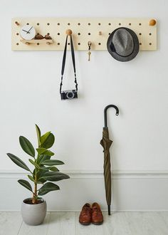 """Peg-it-all """"Skinny"""" Pegboard: Wall-mounted Storage Panel in natural wood"""