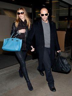 Jason Statham and Rosie Huntington Whiteley arrives at LAX (Los Angeles International Airport).