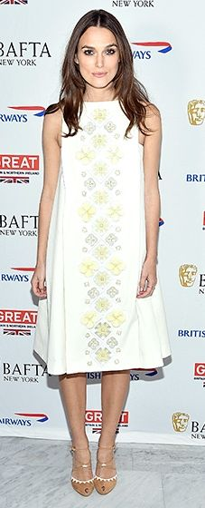 Keira Knightley looked chic in a cream swing dress with yellow floral embellishments at the event.