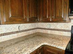 light cabinets with dark granite | ST. CECILIA Granite on Dark Cabinets - traditional - kitchen ...