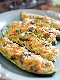 Stuffed zucchini with mushrooms, garlic, red bell peppers, bread crumbs and Parmesan cheese.