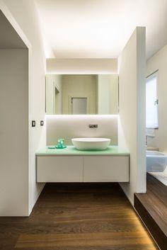 Washroom + dressing table in the bathroom. Apartment renovation in Milan by +R / www.piuerre.com / photo by Alberto Canepa / www.albertocanepa.com / #apartment #renovation #interior #bathroom #washroom #toilette #guarderobe #basin #ceramic #mirror #glass #ledlighting #parquet #wood