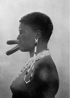 Africa | 'Artificial Deformation - All the women of the Sara tribe have this artificial deformation of the lips as a sign of beauty. The effect is produced by piercing the lips and gradually enlarging the holes by inserting wooden discs, the size of which is increased as the lips get distended' | Image and caption from 'Customs of the World', printed in 1900; photograph by Dr. Kumm
