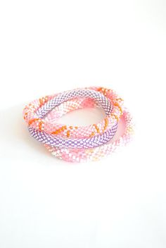 Neon Pink & Purple Lily and Laura bracelets